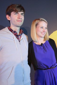 David Karp, left, celebrates the sale of his site Tumblr to Yahoo with its CEO Marissa Mayer, right.
