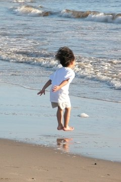 Child at the beach.