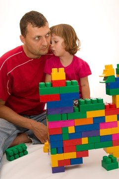 Adults provide a framework to facilitate the child's explorations.