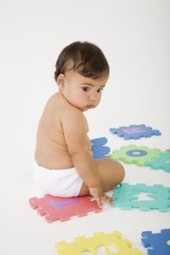 Babies begin learning grammar while learning to talk.