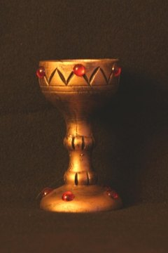 Eucharistic ministers clean chalices. and bowls after Mass.