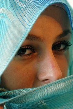 Muslim women wear a variety of coverings over their faces.