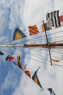An array of signal flags dress the rigging of this ship.
