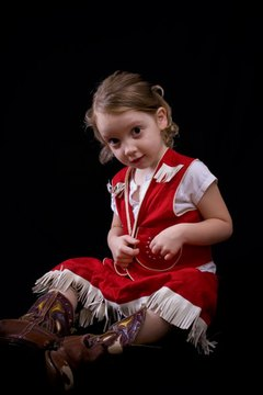 Little girl dressed as a cowgirl