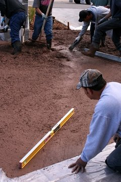 Level the ground and pour a concrete floor.