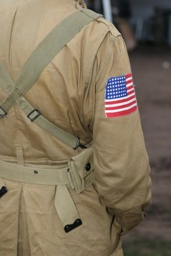 Military shoulder patches signify the wearer's country or unit.