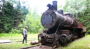 There's A Locomotive Boneyard Deep In The Forest Of Maine That's Both Eerie And Tragic