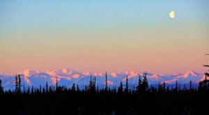 Gaze At A Pink And Violet Sky During The Alpenglow, A Stunning Natural Phenomenon In Alaska