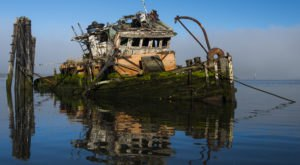 Few People Know About This Slowly Sinking Ship Wreck On The Oregon Coast