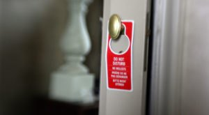 "Hotel ""Do Not Disturb"" Signs Are Disappearing For A Disturbing Reason"