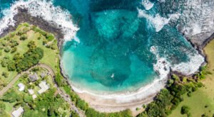 This Crescent Beach Backed By Cliffs Is Our New Favorite Hawaii Destination