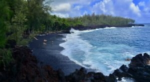The Black Sand Beach In Hawaii That's A Known Dolphin Hangout