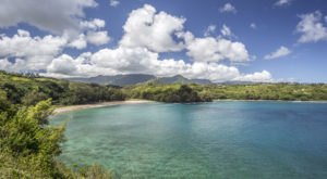The Breathtaking Hawaii Beach Surrounded By Lava Cliffs That's Tailor Made For Summer