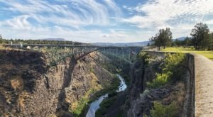 Peer Over The Bridge Into The Deep Chasm Of The Crooked River Gorge In Oregon