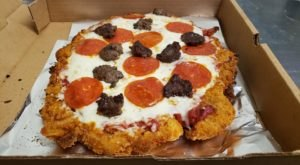 Get Your Favorite Pizza On Top Of A Breaded Tenderloin At Flo's, A Hometown Bar & Grill In Illinois