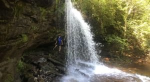 Hike Behind A Waterfall On The 5.6-Mile Schoolhouse Falls Trail In North Carolina