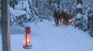Take A Lantern-Lit Sleigh Ride To A Winter Speakeasy In New York At The Oldest Operating Lodge In The Adirondack Park