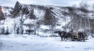 Take A Rustic Horse Drawn Sleigh Ride Through Wyoming's Mountains Straight To A Steakhouse Dinner At Mill Iron Ranch