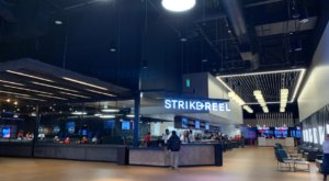 Enjoy The Fun Of A Bowling Alley, Movie Theater, And Arcade All In One At Texas' Strike + Reel