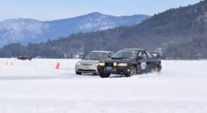 Toast Marshmallows On The Beach While Watching Ice Car Races At Lake George Winter Carnival In New York