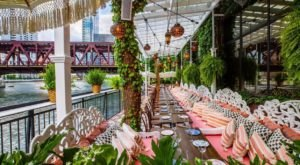 Dine Along The Water On The Covered Patio At Beatnik On The River, A Bohemian Restaurant In Illinois