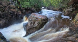 Watch A Waterfall Tumble Over A Rocky Gorge At The Breathtaking Cascade River State Park In Minnesota