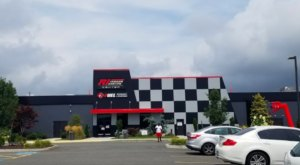Race Go Karts And Test Your Strength At The Axe Bar At R1 Indoor Karting In Rhode Island