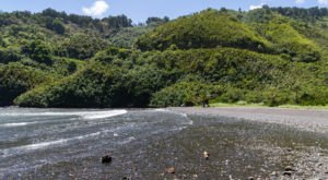 Experience Endless Natural Beauty At Honomanu Bay, One Of Hawaii's Prettiest Black Sand Beaches