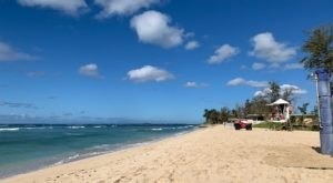 Learn To Surf And Enjoy Plenty Of Amenities At Hawaii's Local Hangout, White Plains Beach
