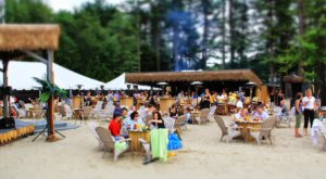 Sink Your Toes In The Sand At Sunset Tiki Bar In Massachusetts