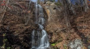 Marvel At A 150-Foot Roadside Waterfall When You Take A Scenic Drive On White Oak Mountain Road In North Carolina