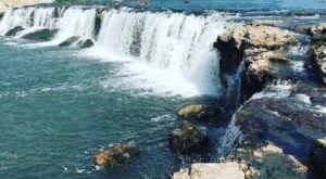 Plan A Visit To Grand Falls, Missouri's Beautifully Blue Waterfall
