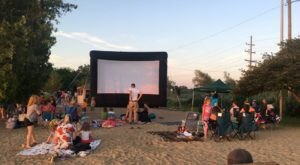 Watch Movies Outdoors On A Picnic Blanket In The Village Of Clarkson Near Detroit This Summer