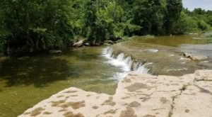 This Easy, 3.8-Mile Trail At Bull Creek Park Leads To One Of Texas' Most Underrated Waterfalls