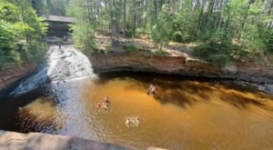 Swim Underneath A Waterfall At This Refreshing Natural Pool In Wisconsin