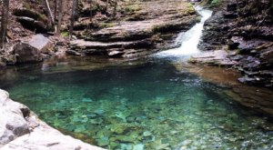 Plan A Visit To Devil's Bathtub, Virginia's Beautifully Blue Waterfall Swimming Hole