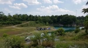 Camp On The Banks Of A Beautifully Blue Quarry Lake At Compound Nature Preserve In West Virginia