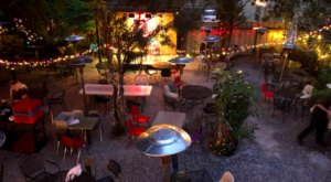 Enjoy A Delicious Meal In An Enchanting Courtyard At Bacchanal In New Orleans