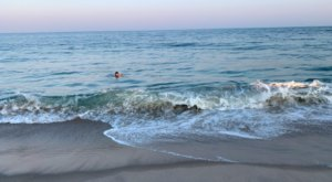 Relax On Golden Sand At Charlestown Breachway In Rhode Island