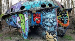 The Abandoned UFO Boat On Oregon's Collins Beach Is A Graffiti Masterpiece