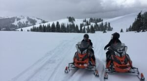 This Guided Snowmobile Tour In The Idaho Backcountry Takes You From Old Faithful To Mesa Falls