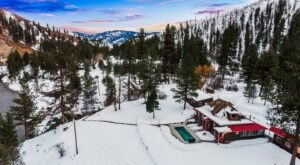 Spend A Night At A Historic Hot Spring Ranch In Idaho While Surrounded By Snow-Capped Pine Trees