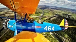 Soar Over The Nation's Newest National Park Aboard A WWII Biplane In West Virginia
