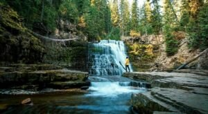You'll Want To Spend All Day At Ousel Falls' Waterfall-Fed Pool In Montana