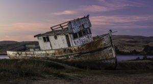 Take A Short Walk Across Wetlands To See A Long-Abandoned Boat In Northern California