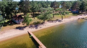 This Little Cottage On Wolf Lake Is Steps Away From A Sandy Beach, And You Can Spend The Night