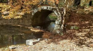Wander Over An Old Stone Bridge At The Arched Bridge Conservation Area In Massachusetts