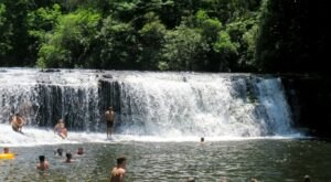 Hike Less Than Half A Mile To This Spectacular Waterfall Swimming Hole In North Carolina