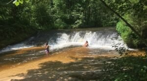 Hike Less Than Two Miles To This Spectacular Waterfall Swimming Hole In Wisconsin