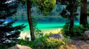 Visit Wade Lake In Montana, A Hidden Gem Beach That Has Glistening Blue Water